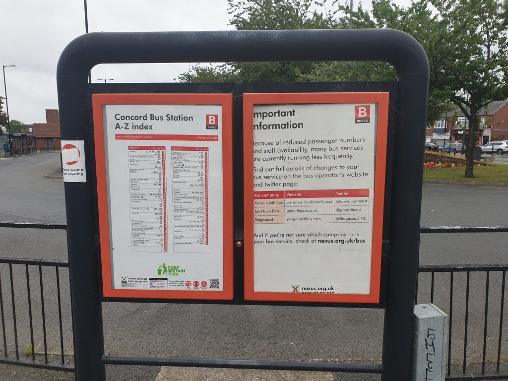 Concord Bus Station information stand, showing outdated posters.